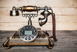 Old telephone on wooden background. Copy space on the bottom. - 78340026