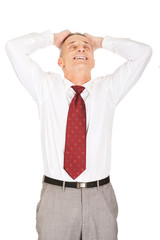 Relaxing businessman holding arms on head