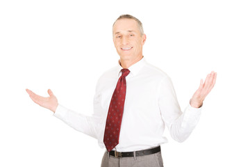 Businessman with hands open in undecided gesture