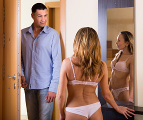 Girl in underwear meeting husband