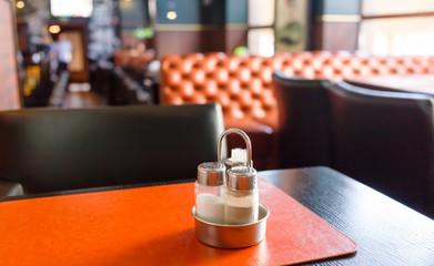pepper and salt shaker on table at restaurant