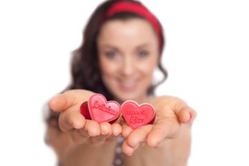 Women holding hearts in her hands.