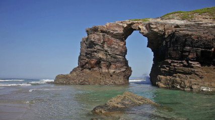 Stone arches on Playa de las Catedrales during outflow, Spain