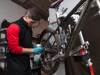 Mechanic repairing a mountain bike