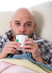 sick man with tea in grippe virus ,flu and headache