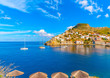 sailing boats enter in the port of Hydra island in Greece - 78343429
