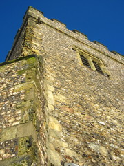 flint and brick church tower 11th century