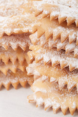 Chiacchiere, italian Carnival pastry heap on white