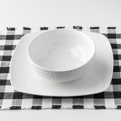 Empty white bowl and plate