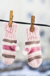 Pink gloves hanging on the clothespin