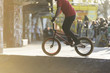 canvas print picture - Unseen bmx biker in a skate park