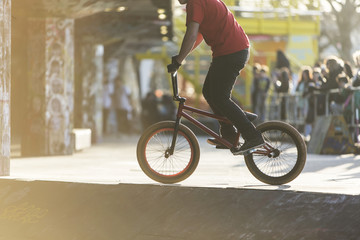 Unseen bmx biker in a skate park