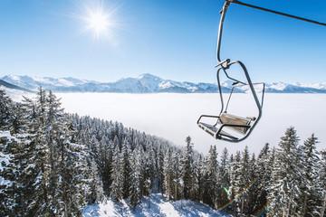 Ski lift and winter mountains