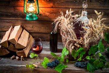 Homemade red wine in a wicker basket
