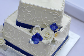 Close-Up of Wedding Cake with Blue and White Flowers