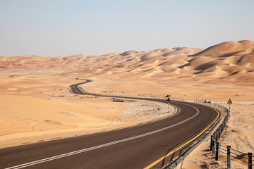 Road through desert in Liwa Oasis, Abu Dhabi, UAE