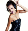 canvas print picture - Sexy woman in disco dancing with headphones