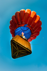 Man in a hot air ballon with flames