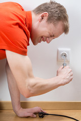 Man fixing socket being electrocuted
