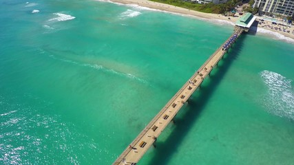 Aerial fishing pier beach FL 4k uhd