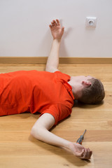 Electrocuted man lying on the floor