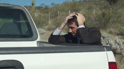 Businessman With Truck Broken Down