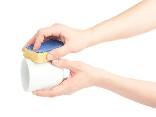 Washing white cup with sponge