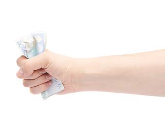 Hand squeezing twenty euro note