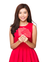 Woman hold with red pocket money