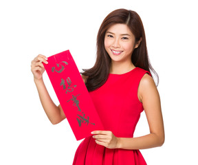 Woman with Fai Chun for Chinese new year, phrase meaning is drea