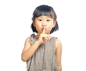 asian little girl finger up to lips for making a quiet gesture i