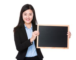 Businesswoman show with blackboard