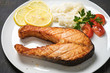 Grilled trout with vegetables and rice, closeup