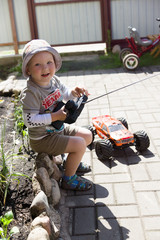 boy and rc car