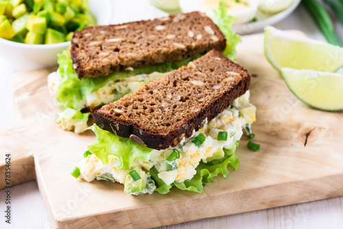 Fotobehang Snack Egg and avocado sandwiches with cream cheese