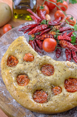 Traditional italian focaccia with cherry tomatoes
