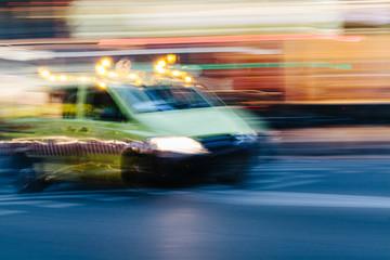 Ambulance Car in a Blurred City Scene