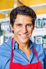 Confident Male Worker Smiling In Hardware Shop