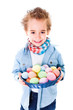 Boy showing an basket with colorful Easter eggs