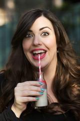 brunette woman drinking milk