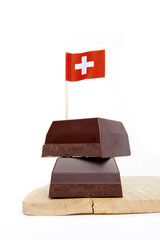 black chocolate isolated on white & paper flag of Switzerland