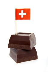 black chocolate isolated on white & paper flag of Switzerland