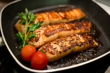 Fresh salmon filles  grilled in a pan