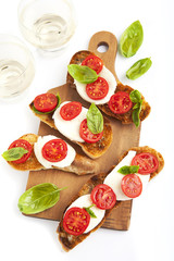 italian bruschetta with cherry tomatoes, mozzarella, fresh basil