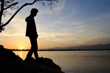 Silhouette of a man on sunset