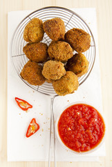 italian fried appetizer snack. eggplant meatballs with spicy tom