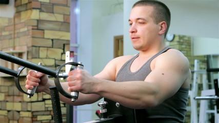 A man trains in a gym closeup