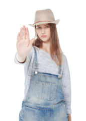 Young teenager girl making stop sign isolated. Focus on palm
