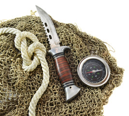 Knife with rope and compass isolated