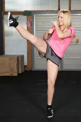 Taekwondo kick boxing woman doing exercise